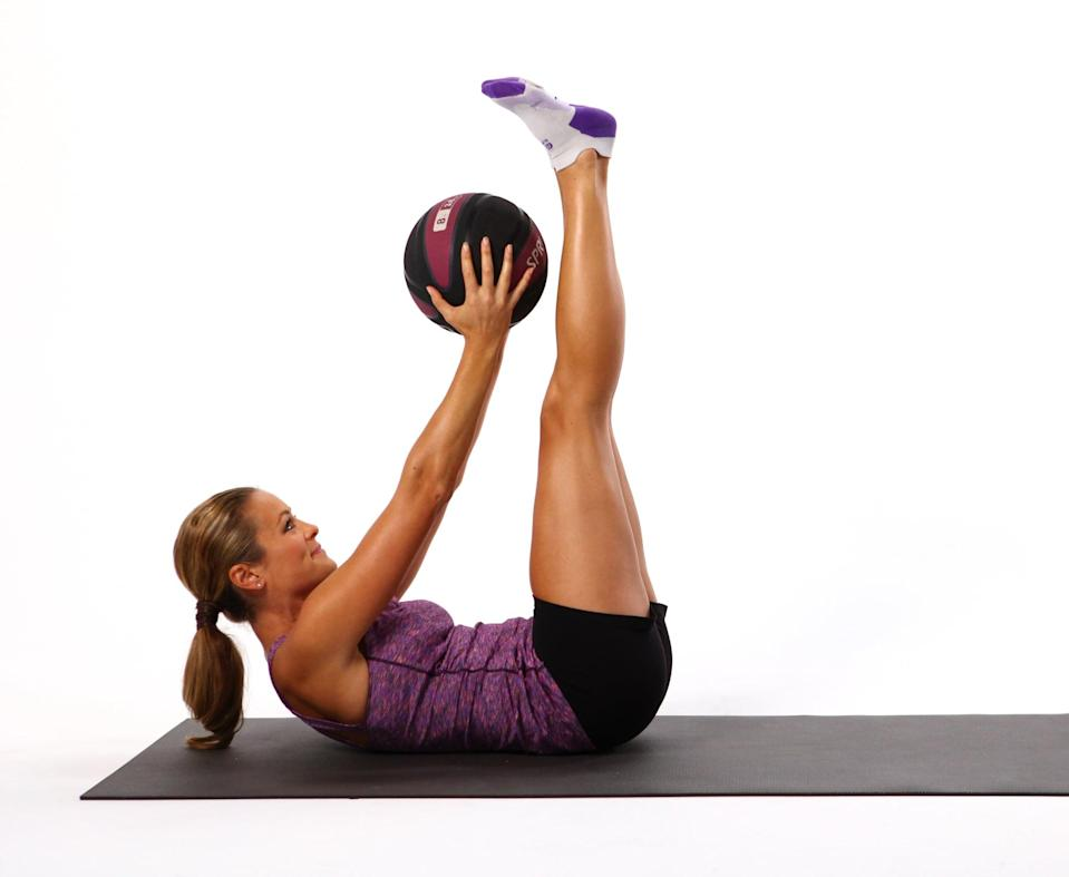 <p>The slow and controlled pulse of this exercise keeps the abs engaged, and adding the weight of a medicine ball kicks your abs into high gear and increases the burn. Choose a weight between five and eight pounds.</p> <ul> <li>Begin lying on your back with your legs in the air, toes toward the ceiling, holding the medicine ball over your chest with straight arms. Engage your abs (bring your navel in toward your spine) to press your low back into the mat while lifting your head, neck, and upper back off the mat.</li> <li>Exhale, and round your low back so the bottom of the pelvis raises as you lift your upper body an inch higher off the mat. Aim the medicine ball toward your ankles as you perform this double crunch. </li> <li>Inhale, and lower your pelvis and upper back an inch toward the floor.</li> </ul>