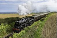 """<p>One of Britain's best heritage railways is the North Norfolk Railway, or the Poppy Line as it is also known. </p><p>The relaxed train journey takes passengers from Sheringham along the coast to Weybourne and through beautiful heathland to Holt.</p><p>Its steam trains are run by volunteers and offer a slow-paced holiday in Norfolk. At Sheringham Station, you'll want to check out the 1950s' waiting room and restored signal box.</p><p><strong>Ride the Poppy Line on Good Housekeeping's tour of Norfolk with former royal correspondent Jennie Bond, or try a Norfolk rail holiday including exclusive entrance to Felbrigg Hall, with great train journeys starting from £495 per person. </strong></p><p><a class=""""link rapid-noclick-resp"""" href=""""https://www.goodhousekeepingholidays.com/tours?locations%5Bsearch%5D=Norfolk%2C+UK&locations%5Bgeo%5D=52.355367%2C0.153555%2C52.992704%2C1.745461"""" rel=""""nofollow noopener"""" target=""""_blank"""" data-ylk=""""slk:FIND OUT MORE"""">FIND OUT MORE</a></p>"""