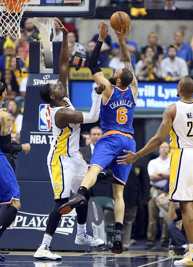 INDIANAPOLIS, IN - MAY 14: Tyson Chandler #6 of the New York Knicks shoots the ball while defended by Roy Hibbert #55 of the Indiana Pacers during Game Four of the Eastern Conference Semifinals of the 2013 NBA Playoffs at Bankers Life Fieldhouse on May 14, 2013 in Indianapolis, Indiana. NOTE TO USER: User expressly acknowledges and agrees that, by downloading and or using this photograph, User is consenting to the terms and conditions of the Getty Images License Agreement. (Photo by Andy Lyons/Getty Images)