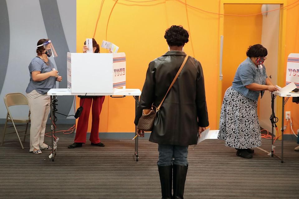 Residents vote at a polling place in the Midtown neighborhood in Milwaukee, Wisconsin on Oct. 20, 2020.