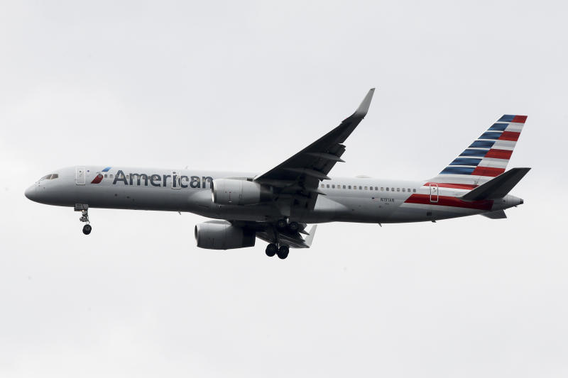 FILE - In this Nov. 7, 2019, file photo an American Airlines jet approaches Philadelphia International Airport in Philadelphia. American Airlines reports financial results Thursday, Jan. 23, 2020. (AP Photo/Matt Rourke, File)