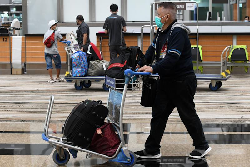 A passenger pushes a trolley in the departure hall at Changi International Airport in Singapore on June 8, 2020, as Singapore prepares to reopen its borders after shutting them to curb the spread of the COVID-19 novel coronavirus. (Photo by Roslan RAHMAN / AFP) (Photo by ROSLAN RAHMAN/AFP via Getty Images)