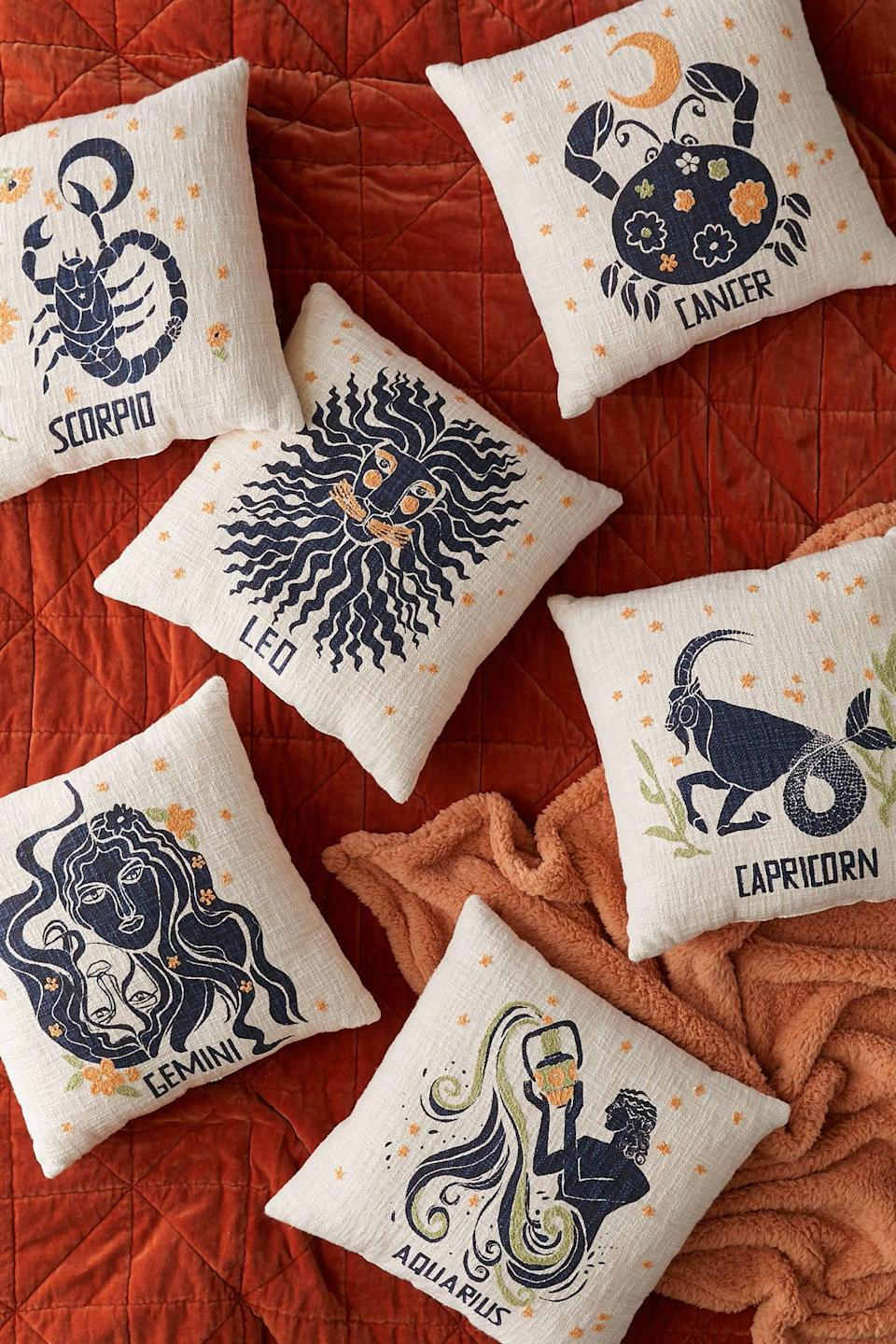 """<p>This <a href=""""https://www.popsugar.com/buy/Zodiac-Throw-Pillow-555120?p_name=Zodiac%20Throw%20Pillow&retailer=urbanoutfitters.com&pid=555120&price=39&evar1=casa%3Auk&evar9=47315088&evar98=https%3A%2F%2Fwww.popsugar.com%2Fhome%2Fphoto-gallery%2F47315088%2Fimage%2F47315187%2FZodiac-Throw-Pillow&list1=shopping%2Curban%20outfitters%2Capartments%2Csmall%20space%20living%2Capartment%20living%2Chome%20shopping&prop13=api&pdata=1"""" class=""""link rapid-noclick-resp"""" rel=""""nofollow noopener"""" target=""""_blank"""" data-ylk=""""slk:Zodiac Throw Pillow"""">Zodiac Throw Pillow</a> ($39, originally $49) makes a cute personalized gift.</p>"""