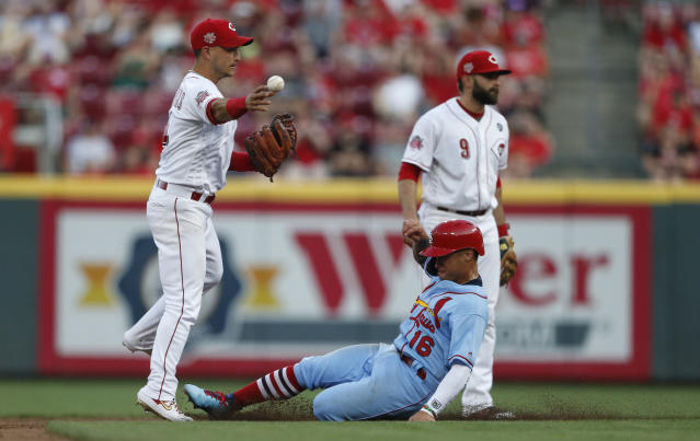 St. Louis Cardinals' Kolten Wong (16) is forced out a second on a double play ball off the bat of Paul DeJong as Cincinnati Reds shortstop Jose Iglesias, left, throws to first during the fifth inning of a baseball game, Saturday, July 20, 2019, in Cincinnati. Backing up the play is Reds second baseman Jose Peraza (9). (AP Photo/Gary Landers)