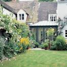 <p><span>Dark green paintwork helps this gothic design by Vale Garden Houses blend </span><span>with the garden</span></p>