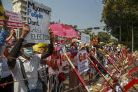 Anti-coup protesters rally close to the Indonesian Embassy in Yangon, Myanmar, Wednesday, Feb. 24, 2021. Anti-coup protesters gathered outside the Indonesian Embassy following reports that Indonesia was seeking to have fellow members of the Association of Southeast Asian Nations to agree on an action over the Myanmar's coup that would hold the junta to its promise to hold free and fair elections in a year's time. The Indonesia Foreign Ministry has denied the report. (AP Photo)
