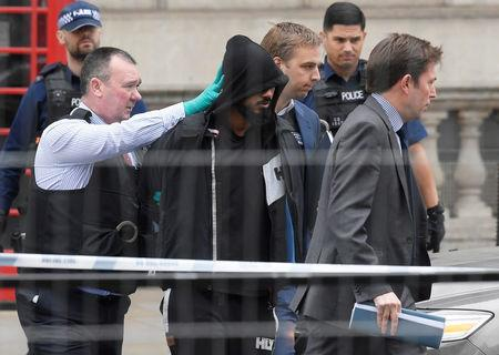 A man is led away by police in Westminster after an arrest was made on Whitehall in central London