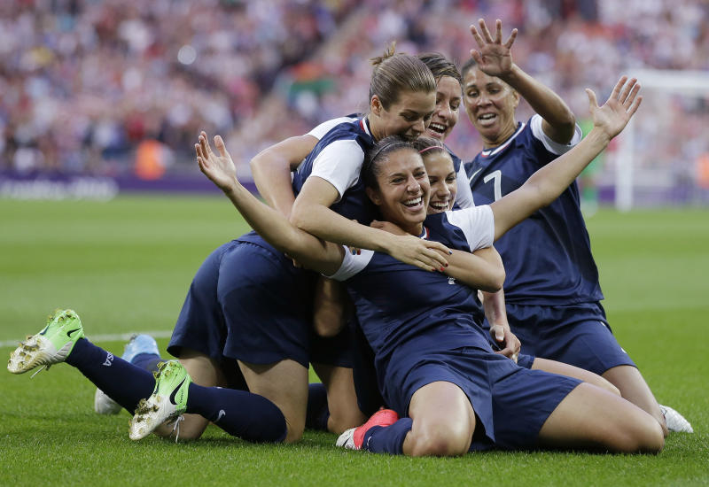 FILE - In this Thursday, Aug. 9, 2012 file photo, United States' Carli Lloyd, right, celebrates with teammates after scoring during the women's soccer gold medal match against Japan at the 2012 Summer Olympics, in London. (AP Photo/Ben Curtis, File)