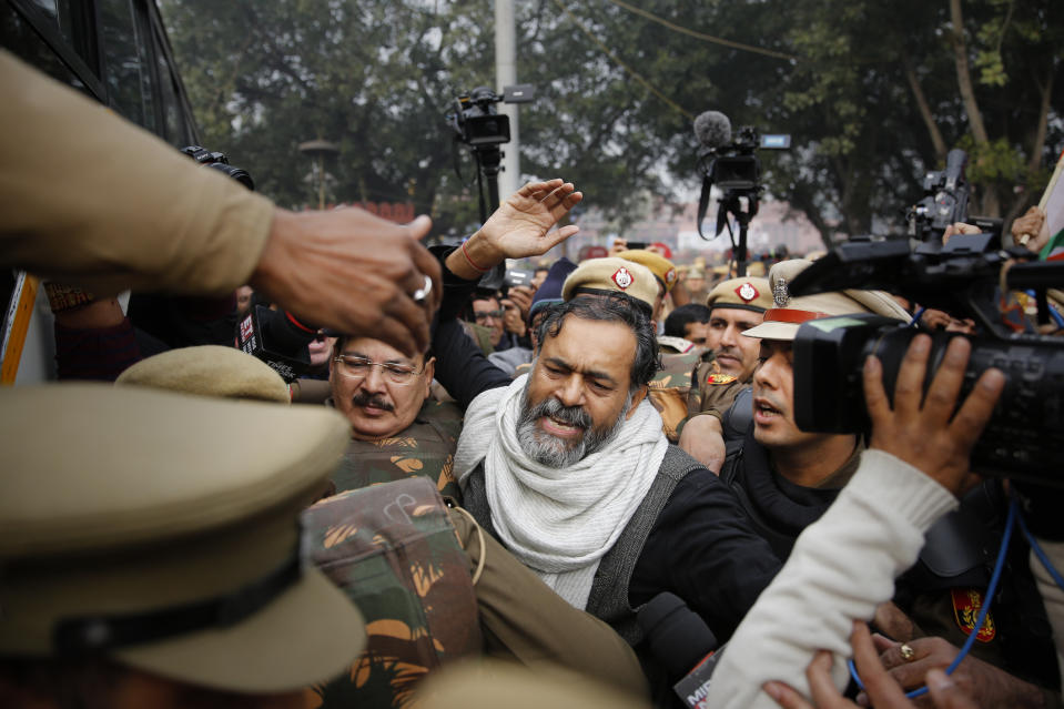 Swaraj India party chief Yogendra Yadav, center, is detained by police near the historic Red Fort in New Delhi, India, Thursday, Dec. 19, 2019. Police detained several hundred protestors in some of India's biggest cities Thursday as they defied a ban on assembly that authorities imposed to stem widespread demonstrations against a new citizenship law that opponents say threatens India's secular democracy. Dozens of demonstrations were to take place around country as opposition grows to a new citizenship law that excludes Muslims. The law has sparked anger at what many see as the government's push to bring India closer to a Hindu state. (AP Photo/Altaf Qadri)