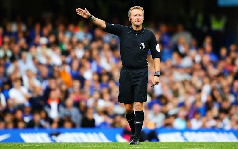 Referee Graham Scott gestures during the Premier League match between Chelsea FC and Leicester City - Getty Images Europe