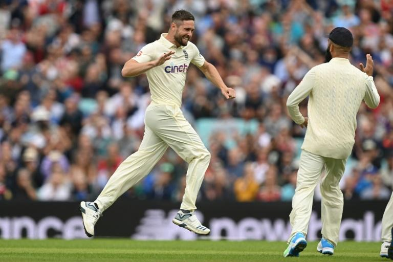 Early strike: England's Chris Woakes celebrates after taking the wicket of India's Rohit Sharma on the first day of the fourth Test at the Oval on Thursday (AFP/DANIEL LEAL-OLIVAS)