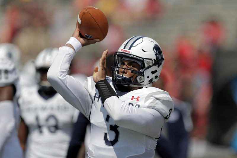 Howard quarterback Caylin Newton warms up prior to a college football game against Maryland on, Aug. 31, 2019. (AP Photo/Julio Cortez)