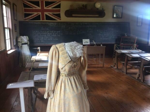 The Lower Bedeque schoolhouse is pictured in 2015, complete with a tailor's dummy clad in a dress that a schoolteacher might have worn in the late 1800s.  (Nancy Russell/CBC - image credit)