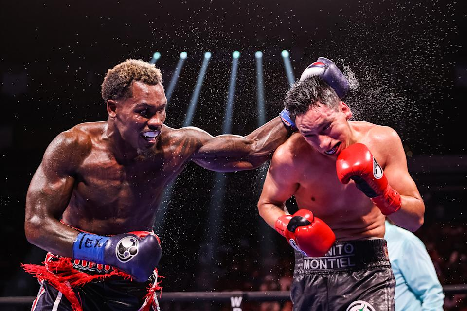 HOUSTON, TEXAS - JUNE 19: Jermall Charlo and Juan Macias Montiel exchange punches during their WBC middleweight title fight at Toyota Center on June 19, 2021 in Houston, Texas. (Photo by Carmen Mandato/Getty Images)