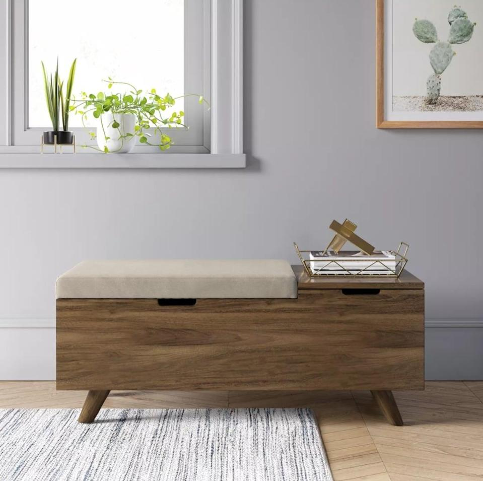 <p>This affordable <span>Project 62 Meller Wood and Upholstered Storage Bench</span> ($180) looks double the price.</p>