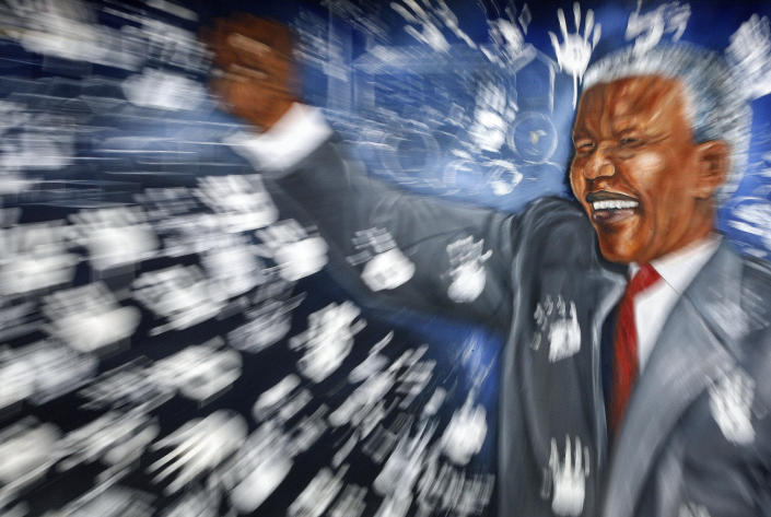 """FILE - This Dec. 11, 2012 shows a mural depicting former South African President Nelson Mandela in Alexandra township, north of Johannesburg. Mandela was admitted to a hospital on Saturday, March 9 2013, for a scheduled medical check-up and doctors say there is no cause for """"alarm,"""" the president's office said. (AP Photo/Themba Hadebe, File)"""