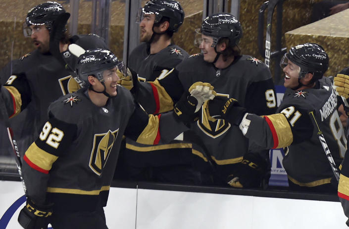 Vegas Golden Knights left wing Tomas Nosek (92) is congratulated after scoring against the Anaheim Ducks during the first period of an NHL hockey game Thursday, Jan. 14, 2021, in Las Vegas. (AP Photo/Isaac Brekken)