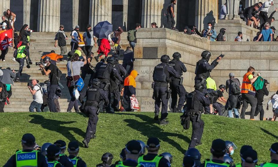 Riot police disperse the crowds at the Shrine of Remembrance during Melbourne's lockdown on Wednesday.