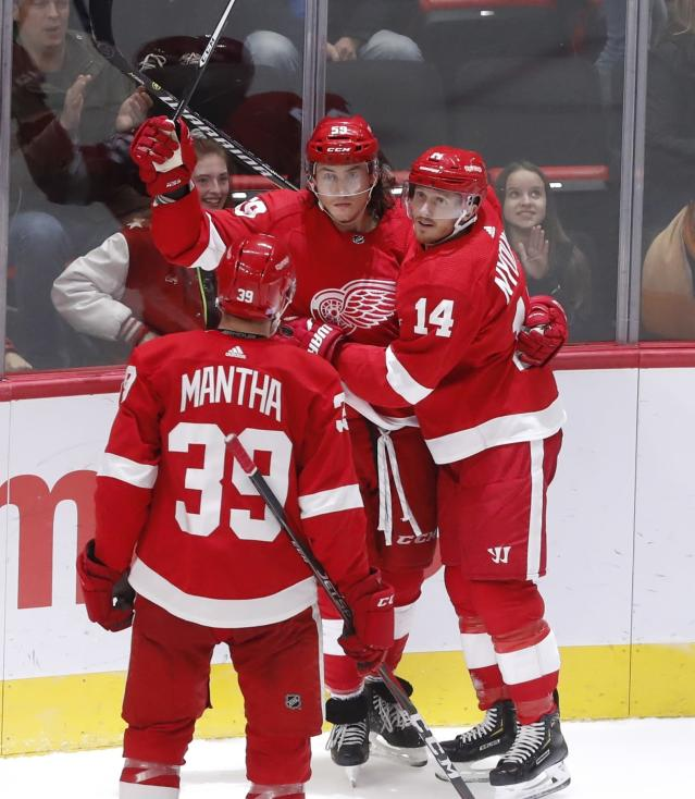 Detroit Red Wings left wing Tyler Bertuzzi (59) is hugged by right wing Gustav Nyquist (14) after scoring a goal during the third period of an NHL hockey game against the Edmonton Oilers, Saturday, Nov. 3, 2018, in Detroit. Edmonton won, 4-3. (AP Photo/Carlos Osorio)