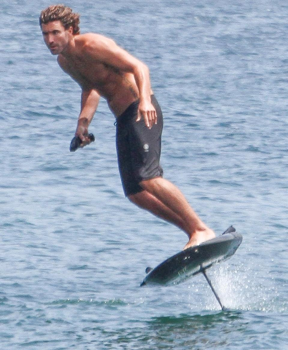 <p>Brody Jenner glides above the ocean on Monday while riding his electric hydrofoil surfboard in Malibu.</p>