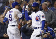 Chicago Cubs' Javier Baez, left, celebrates his home run against the New York Mets with Jason Heyward during the seventh inning of a baseball game Thursday, June 20, 2019, in Chicago. (AP Photo/Jim Young)