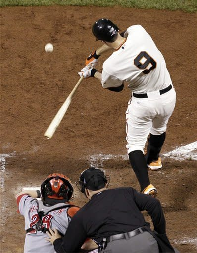 San Francisco Giants' Brandon Belt (9) hits a single in the fifth inning during Game 2 of the National League division baseball series against the Cincinnati Reds in San Francisco, Sunday, Oct. 7, 2012. (AP Photo/Marcio Jose Sanchez)
