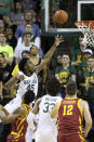 Baylor guard Davion Mitchell (45) is fouled by Iowa State forward Zion Griffin as he scores during the first half of an NCAA college basketball game Wednesday Jan. 15, 2020, in Waco, Texas. (AP Photo/Jerry Larson)