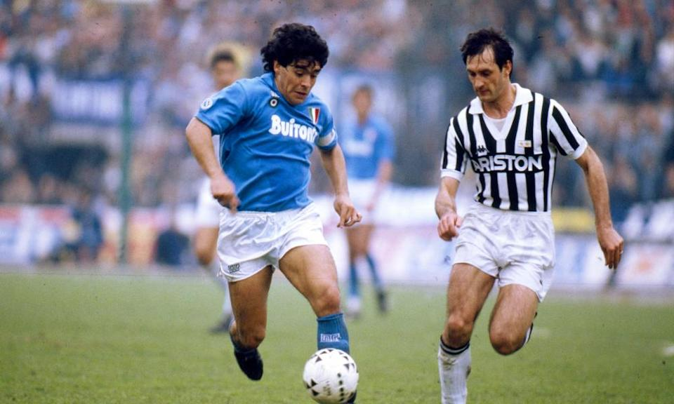 Maradona goes up against Juventus's Luigi De Agostini during his time at Napoli