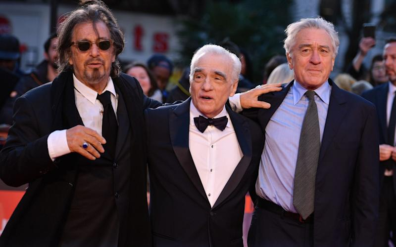"""US actor Al Pacino, US filmmaker Martin Scorsese and US actor Robert De Niro pose on the red carpet as they arrive to attend the international premiere of the film """"The Irishman"""" - AFP"""