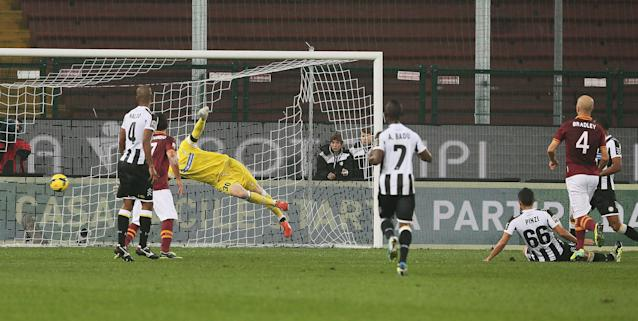 AS Roma's Michael Bradley, of the United States, right, scores during the Serie A soccer match between Udinese and AS Roma, at the Friuli Stadium in Udine, Italy, Sunday, Oct. 27, 2013. (AP Photo/Paolo Giovannini)