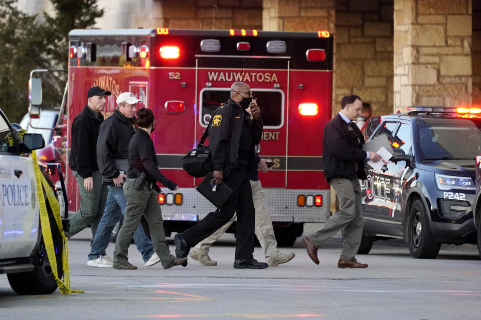 Police officials walk to the Mayfair Mall on November 20, 2020, in Wauwatosa, Wisconsin. / Credit: Nam Y. Huh / AP
