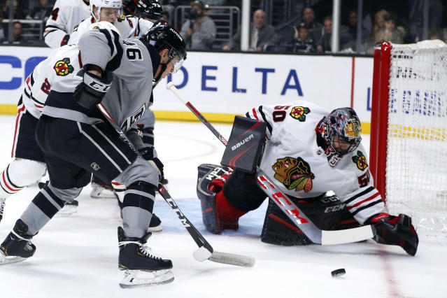 Chicago Blackhawks goalie Corey Crawford (50) makes a save on a shot by Los Angeles Kings forward Blake Lizotte (46) during the second period of an NHL hockey game Saturday, Nov. 2, 2019, in Los Angeles. (AP Photo/Ringo H.W. Chiu)