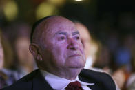 David Einhorn, 95, sheds a tear as he watches Orthodox Jewish singer Yaakov Shwekey perform at an event held to honor him and dozens of other Holocaust survivors, Monday, June 14, 2021, at the Yeshivah of Flatbush theater at Joel Braverman High School in the Brooklyn borough of New York. It was the first large gathering for New York-area Holocaust survivors after more than a year of isolation due to the coronavirus pandemic. (AP Photo/Jessie Wardarski)