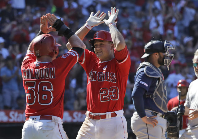 Los Angeles Angels' Matt Thaiss (23) celebrates his three-run home run at home plate with teammate Kole Calhoun (56) during the eighth inning of a baseball game against the Seattle Mariners; Sunday, July 14, 2019, in Anaheim, Calif. (AP Photo/Marcio Jose Sanchez)