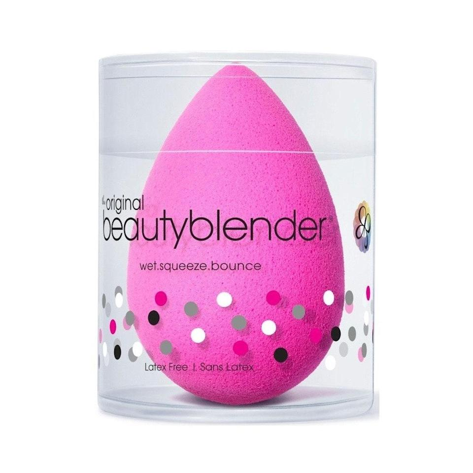 """When it comes to makeup bag staples, you can't gloss over the iconic <a href=""""https://www.allure.com/review/beauty-blender-sponge?mbid=synd_yahoo_rss"""" rel=""""nofollow noopener"""" target=""""_blank"""" data-ylk=""""slk:Beautyblender Original"""" class=""""link rapid-noclick-resp"""">Beautyblender Original</a>. This <a href=""""https://www.allure.com/story/best-makeup-blending-sponges?mbid=synd_yahoo_rss"""" rel=""""nofollow noopener"""" target=""""_blank"""" data-ylk=""""slk:latex-free sponge"""" class=""""link rapid-noclick-resp"""">latex-free sponge</a> flawlessly blends foundation, cream blushes, liquid highlighters, and so much more for an airbrushed-like finish. Ensure that your Beautyblender is damp — meaning, wet it, and then squeeze the excess water out — before going to town with your product, which is seamlessly pressed into skin and doesn't get absorbed into the sponge along the way. $20, Amazon. <a href=""""https://www.amazon.com/BEAUTYBLENDER-ORIGINAL-Makeup-Foundations-Powders/dp/B07VBNQ367"""" rel=""""nofollow noopener"""" target=""""_blank"""" data-ylk=""""slk:Get it now!"""" class=""""link rapid-noclick-resp"""">Get it now!</a>"""