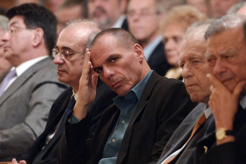 Greece's Finance Minister Yanis Varoufakis (C) attends the bank's of Greece annual report in Athens on February 26, 2015 (AFP Photo/Louisa Gouliamaki)