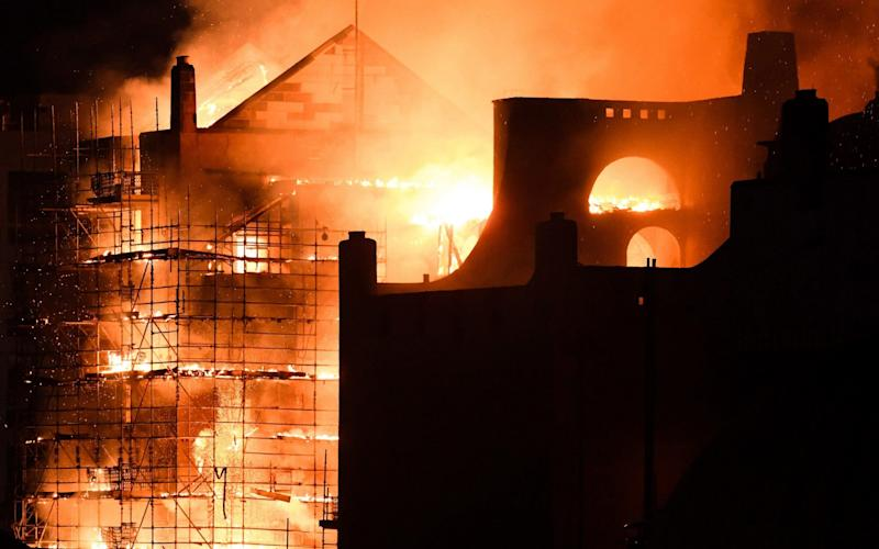 Fire fighters battle a blaze at the Mackintosh Building at the Glasgow School of Art for the second time in four years in June - Getty Images Europe