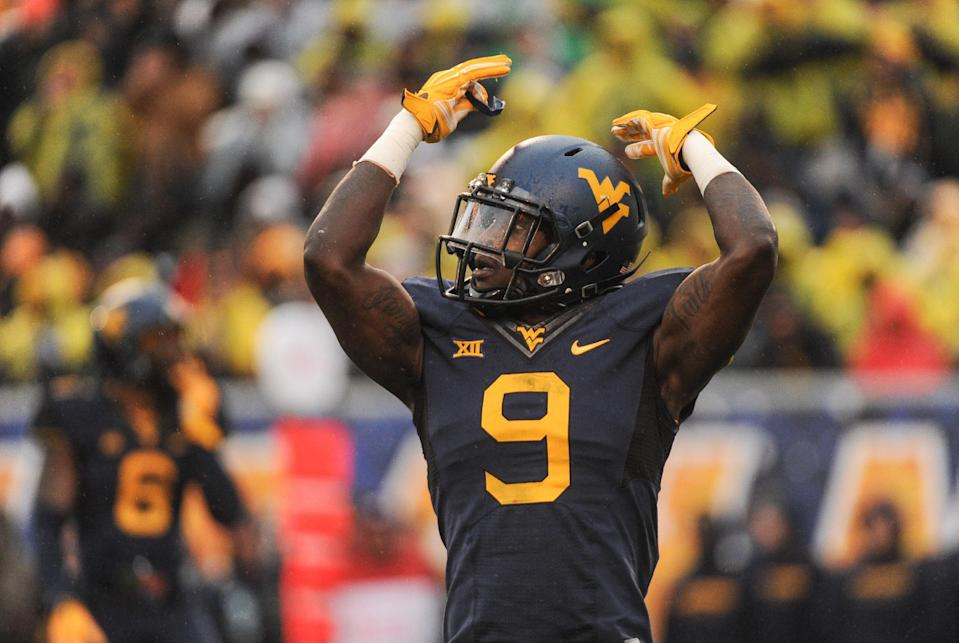 West Virginia's KJ Dillion (9) pumps up the crowd during the second quarter of an NCAA college football game against TCU in Morgantown, W.Va., Saturday, Nov. 1, 2014. (AP Photo/Tyler Evert)