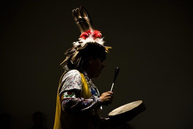 <p>Jordan Smith of the Mohawk Nation Bear Clan performs with the Longhouse Singers and Dancers representing the Oneida Nation at the Museum of the American Revolution in Philadelphia, Pa., Monday, Oct. 9, 2017. (Photo: Matt Rourke/AP) </p>