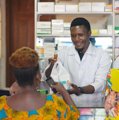 A pharmacist dispenses medical products to a customer in Lagos, Nigeria. Photo Credit: Chukwudera Obumselu