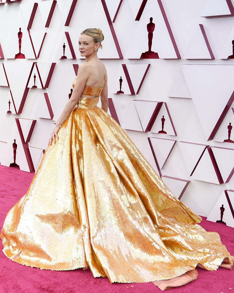 """<p><a class=""""link rapid-noclick-resp"""" href=""""https://www.popsugar.com/Carey-Mulligan"""" rel=""""nofollow noopener"""" target=""""_blank"""" data-ylk=""""slk:Carey Mulligan"""">Carey Mulligan</a>'s hair looked simple from the front but the back showed a unique twisted updo style. </p>"""