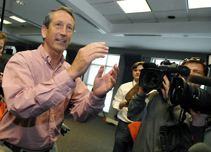 Former South Carolina Gov. Mark Sanford gestures after voting at a polling place in Charleston, S.C., Tuesday, May 7, 2013. Sanford, a Republican, and Elizabeth Colbert Busch, a Democrat and sister of political satirist Stephen Colbert, are to face off for the 1st Congressional District seat, that was vacated when Tim Scott was appointed to the U.S. Senate. Green Party candidate Eugene Platt also is on the ballot. (AP Photo/Rainier Ehrhardt)