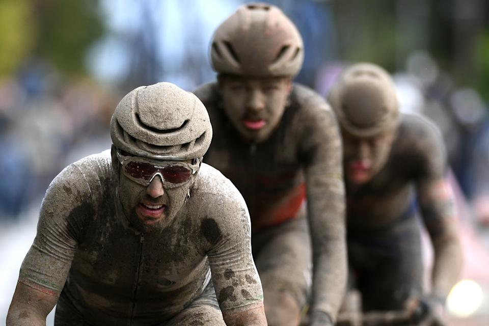 ROUBAIX, FRANCE - OCTOBER 03: Sonny Colbrelli of Italy and Team Bahrain Victorious covered in mud competes in the breakaway during the 118th Paris-Roubaix 2021 - Men's Eilte a 257,7km race from Compiègne to Roubaix / #ParisRoubaix / on October 03, 2021 in Roubaix, France. (Photo by Tim de Waele/Getty Images)