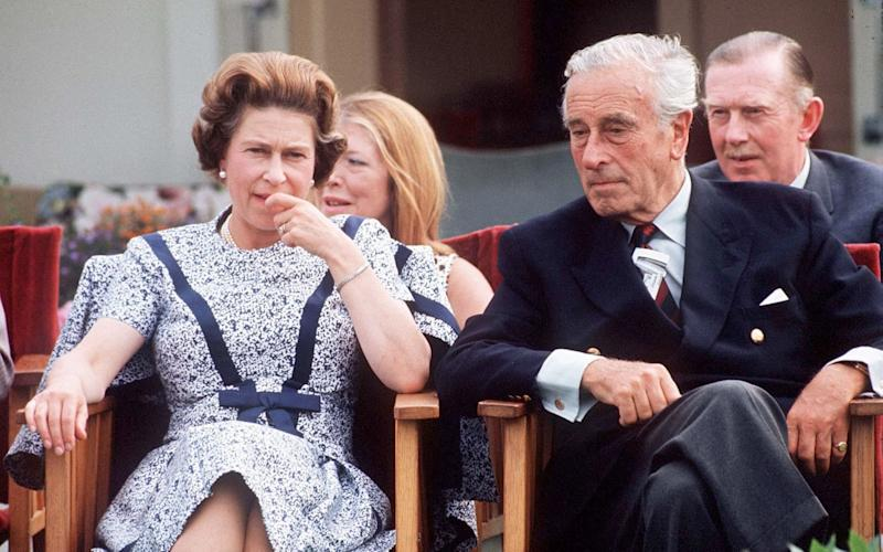 Queen Elizabeth II chats with Lord Louis Mountbatten at the Guards Polo Club in Windsor, in 1975, eight years after the plot to topple Harold Wilson - Getty Images