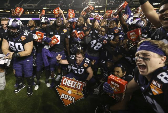 TCU players celebrate a 10-7 overtime win against California in the Cheez-It Bowl on Wednesday in Phoenix. (AP)
