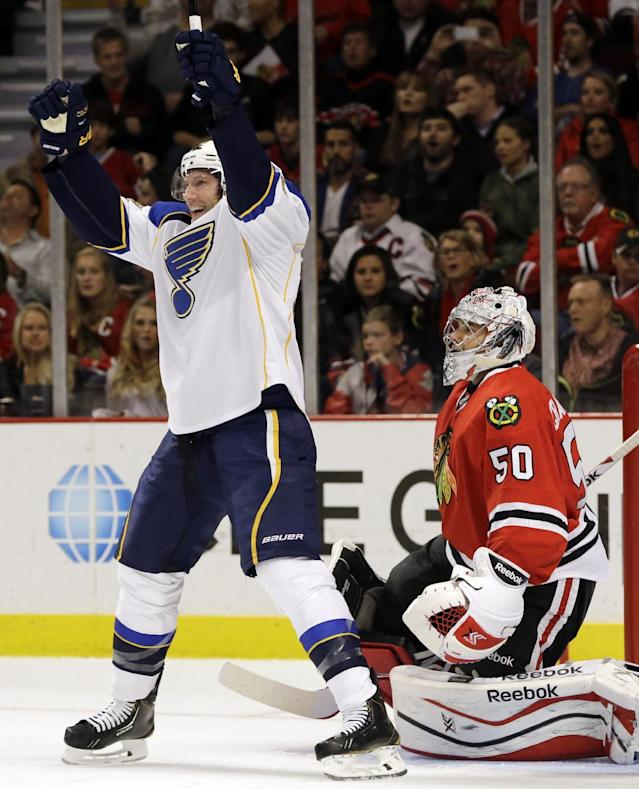 St. Louis Blues' David Backes (42) celebrates after scoring his goal as Chicago Blackhawks goalie Corey Crawford (50) reacts during the first period of an NHL hockey game in Chicago, Thursday, Oct. 17, 2013. (AP Photo/Nam Y. Huh)