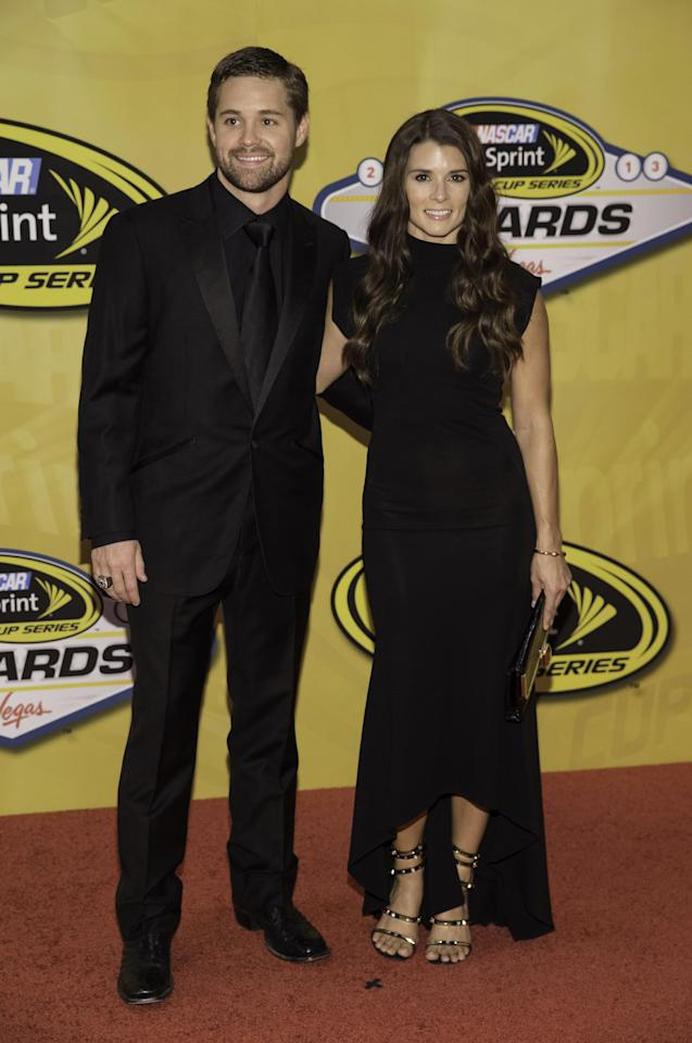 Ricky Stenhouse Jr. and Danica Patrick arrive at The NASCAR Sprint Cup Series auto racing awards ceremony Friday, Dec. 6, 2013 at The Wynn Resort & Casino in Las Vegas. (AP Photo/Eric Jamison)