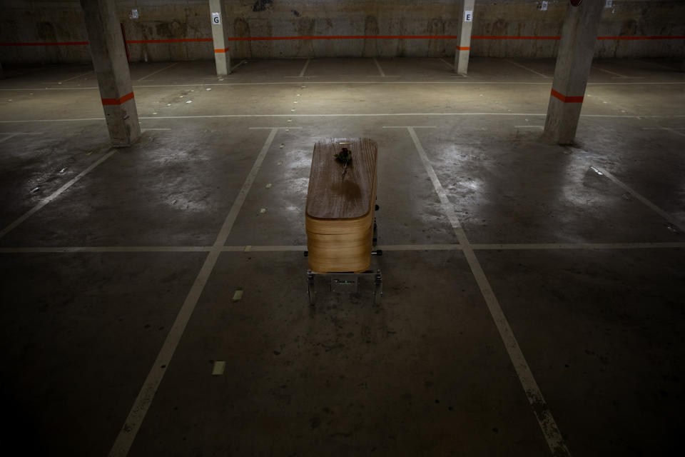 The coffin of the last COVID-19 victim stored at an underground parking garage that was turned into a morgue, at the Collserola funeral home in Barcelona, Spain. May 17, 2020. A funeral home in Barcelona has closed a temporary morgue it had set up inside its parking garage to keep the victims of the Spanish city's coronavirus outbreak. The last coffin was removed and buried on Sunday. In 53 days of use, the temporary morgue has held more than 3,200 bodies. (AP Photo/Emilio Morenatti)