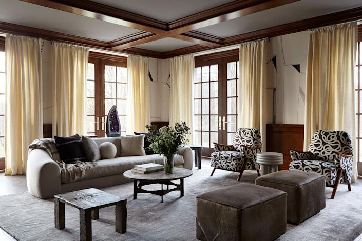 "<div class=""caption""> The adjoining family room and den are the only places where Story chose to maintain the dark wood paneling that was original to the home. ""We felt that the wood wouldn't feel so stark against the cooler gray tones,"" she says. Midcentury Swedish armchairs upholstered in <a href=""https://www.pierrefrey.com/en/page/maison-le-manach"" rel=""nofollow noopener"" target=""_blank"" data-ylk=""slk:Le Manach"" class=""link rapid-noclick-resp"">Le Manach</a> fabric play off a graphic wall covering by <a href=""https://porterteleo.com/"" rel=""nofollow noopener"" target=""_blank"" data-ylk=""slk:Porter Teleo"" class=""link rapid-noclick-resp"">Porter Teleo</a>; they sit opposite a custom sofa by <a href=""https://roomonline.com/"" rel=""nofollow noopener"" target=""_blank"" data-ylk=""slk:ROOM"" class=""link rapid-noclick-resp"">ROOM</a> upholstered in <a href=""https://www.hollandandsherry.com/"" rel=""nofollow noopener"" target=""_blank"" data-ylk=""slk:Holland & Sherry"" class=""link rapid-noclick-resp"">Holland & Sherry</a> wool. </div>"