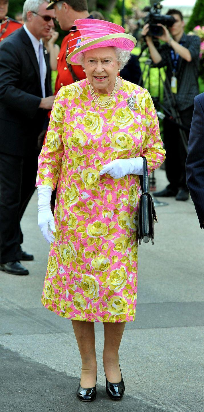 <p>In July 2010, the Queen attended the unveiling of a statue of herself in Winnipeg, Canada. She wore a pink dress with bright yellow roses and a vibrant pink hat to the event. </p>